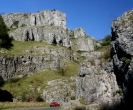 Cheddar Gorge with red car for scale