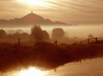A beautiful misty sunrise with Glastonbury Tor.