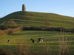 Glastonbury Tor in late afternoon sunshine.