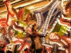 Masqueraders Carnival Club: Jester Choo Choo. A large carnival float with brightly lit moving jesters and dancers.