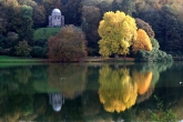 The classic picture of autumn colours with relections in the lake. The temple of Apollo is nestling in a small clearing amongst the trees.