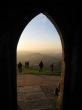 Looking through the tower's doorway towards Wearyall Hill as the sun goes down