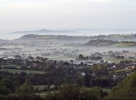 Mist over the Levels with Glastonbury Tor in the distance.